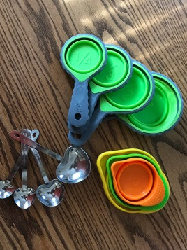 Measuring cups and spoons for portion control.